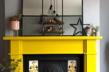 22 a vintage fireplace with floral tiles on each side and a sunny yellow mantel looks very refined and vintage-inspired