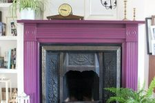 23 a vintage fireplace with a purple mantel around, some potted plants, candle lanterns and mirrors
