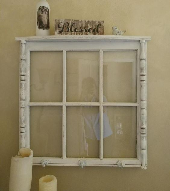 a window frame used as a shelf is a stylish idea for a rustic, shabby chic or just vintage interior and will look cool