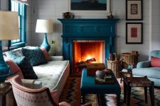 24 a teal fireplace is a natural solution for a coastal living room and other teal items echo with it perfectly creating a cohesive look
