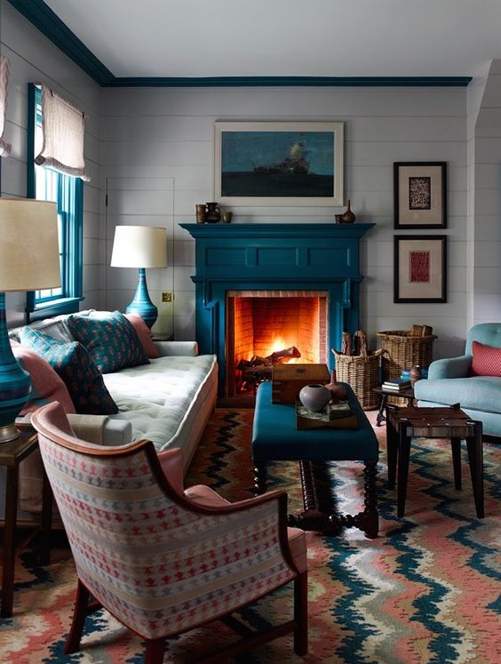 a teal fireplace is a natural solution for a coastal living room and other teal items echo with it perfectly creating a cohesive look