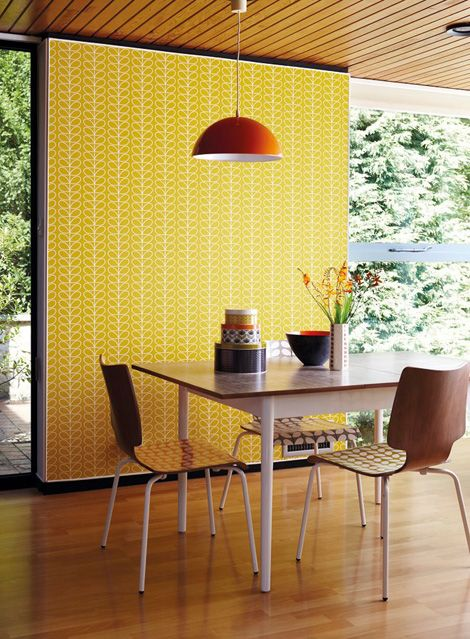 bold yellow and white printed retro sixties' wallpaper accentuates a breakfast nook and brings color and pattern here