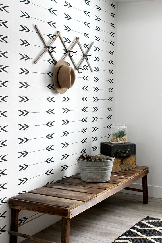 monochrome wallpaper to accentuate the boho and rustic entryway area and bring a pattern touch to the space