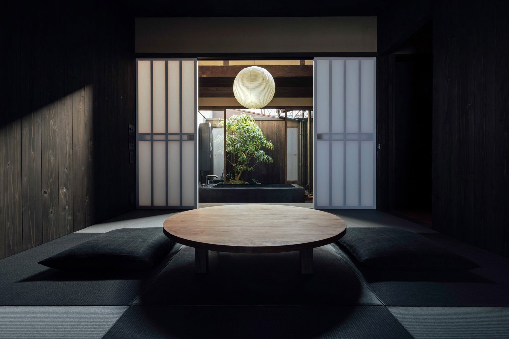 This Japanese house in Kyoto is a restored dwelling with moody and very tranquil interiors
