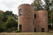 01 This unique house in Belgium is built of reclaimed bricks and is dotted with large windows here and there also featuring a gorgeous shape