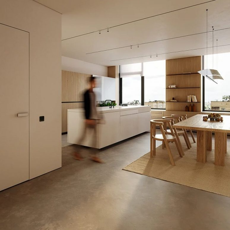 The large main layout is flooded with natural light, there's wooden and white furniture