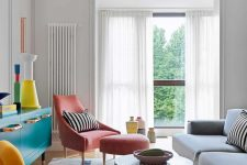 02 The living room features colorful furniture and objects, striped accents and bold accessories