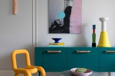 Bright artworks like these ones can be seen throughout the dwelling