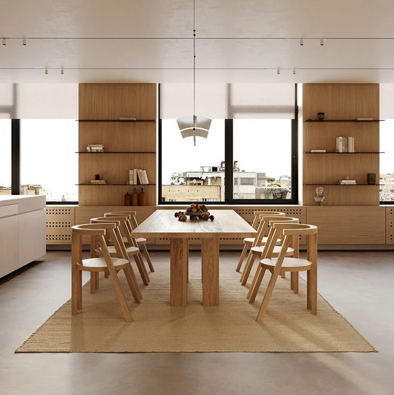 The dining zone is done with a chic table and scultupral chairs that define the look
