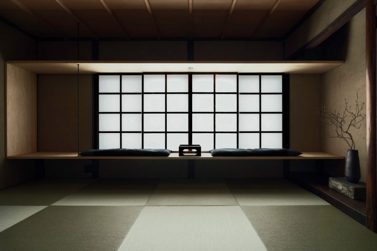 This is a yoga space with very minimalist furniture and traditional Japanese windows