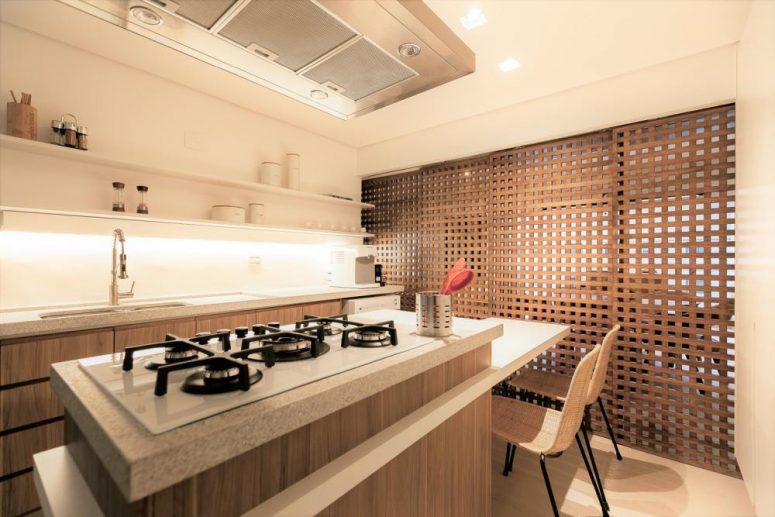 When the sliding doors are closed, the kitchen becomes a smaller but also cozier room
