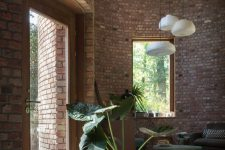 05 Glass doors and large windows brign much natural light in, there are statement plants add coziness here