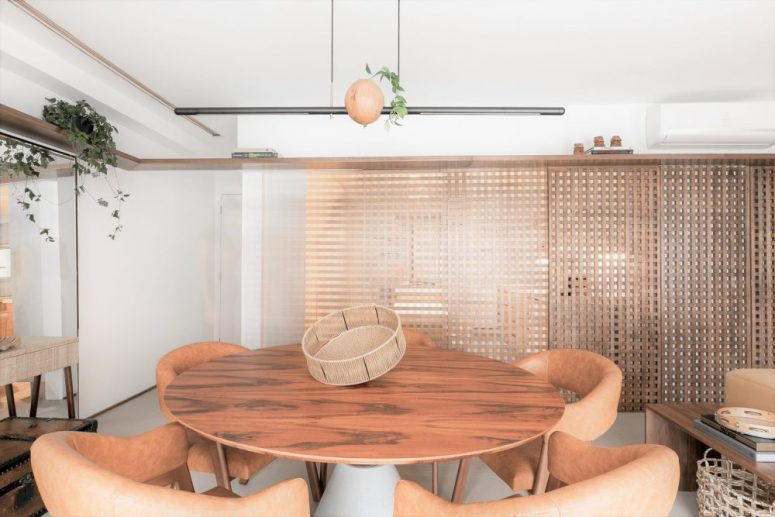The dining space is done with a round table and quirky leather chairs, which highlight the table