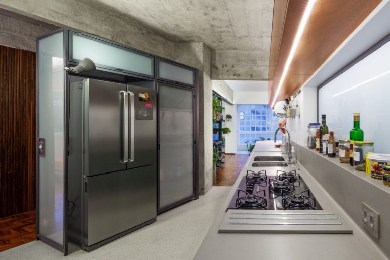 The kitchen has an asymmetrical layout, with one of the wall placed at an angle
