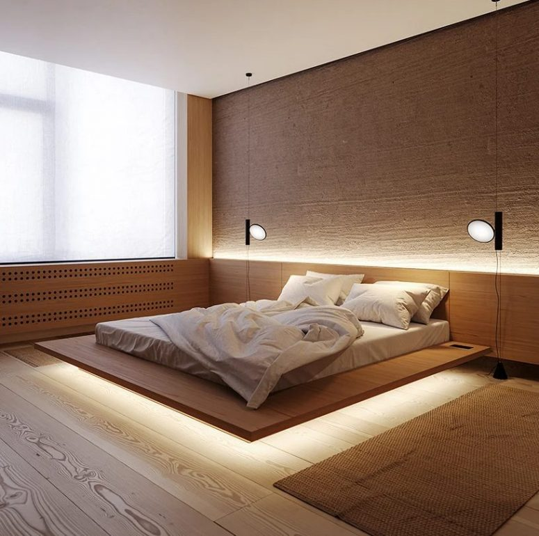 The master bedroom is super laconic, with a floating bed with built-in lights and some rugs