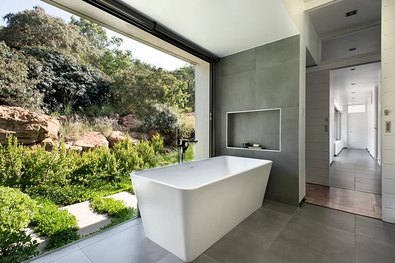 a modern bathroom design with a cool courtyard view