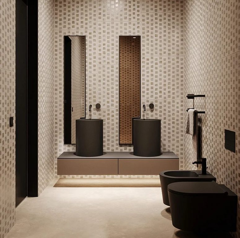 The bathroom is clad with catchy printed tiles and features black appliances