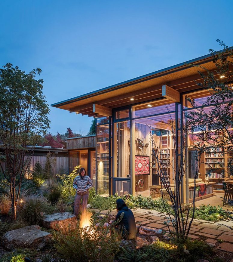 There's a cozy patio with much greenery and lights, and all the spaces are connected to it