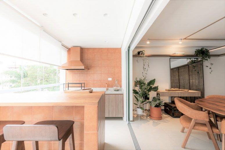 The apartment is also decorated with vegetation which complements its nature-inspired look wonderfully
