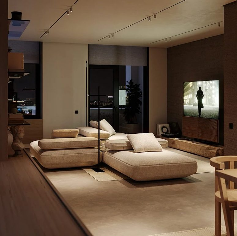 The living room is all-neutral, with a cool sectional, a TV and some more shelves