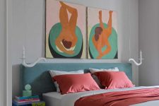 08 The bedroom shows off a grey upholstered bed, colorful nightstands and bold artworks