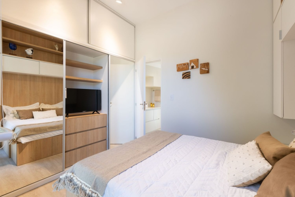 The bedroom shows off much hidden storage space, a comfy bed and some lights   who needs more in such a space