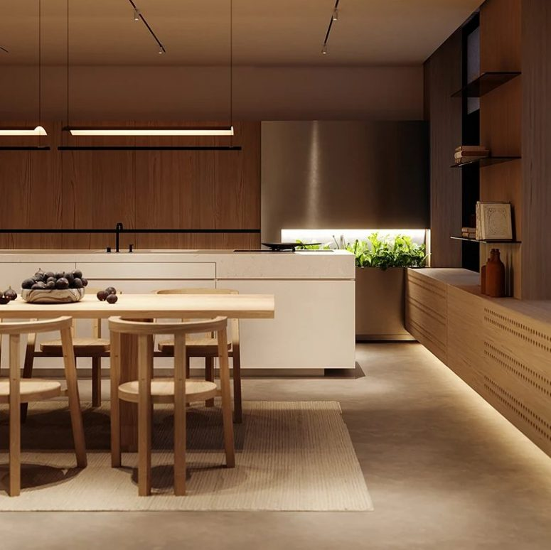 The kitchen shows off sleek cabinetry and a white kitchen island plus elegant lightting