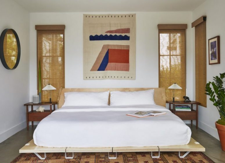 The master bedroom is done with bold touches, comfortable mid-century modern furniture and burlap shades
