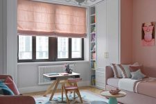 10 The kid's room is done with blush and pink furniture, blush curtains, a geometric rug and catchy tables