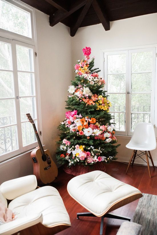 a Christmas tree decorated with blooms and lights is a unique boho chic idea to arise your inner flower child