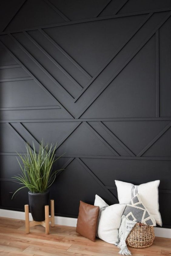 a black geometric paneled wall is a cool solution for a boho, mid-century modern and just elegant contemporary space