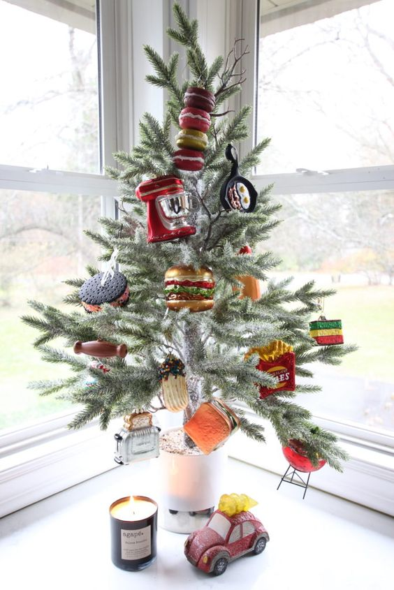 a creative and very fun tabletop Christmas tree decorated with faux food and applainces is a fantastic and hilarious idea for your kitchen