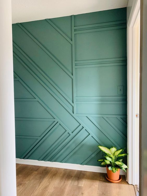 a green geometric wall is a creative option of modern wainscoting and it will add both pattern and color to the space