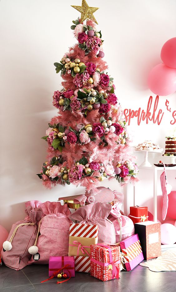a bold christmas tree with lots of pink decor