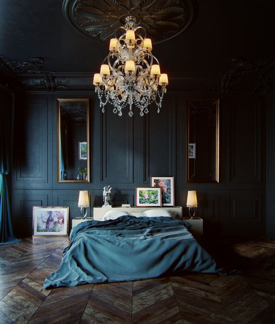 a moody luxurious bedroom with black panel walls, vintage mirrors and a chandelier and stunning parquet floors