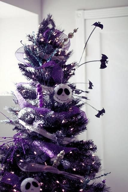 a shiny purple Christmas tree with lights, bats, beads and sheer Skellington ornaments is a bold solution for Christmas