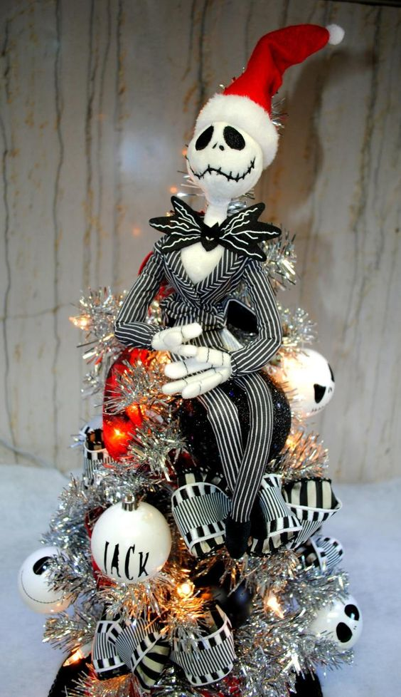 a silver lit up Nightmare Before Christmas tree with Jack ornaments and striped ribbons is a lovely and bold idea to rock