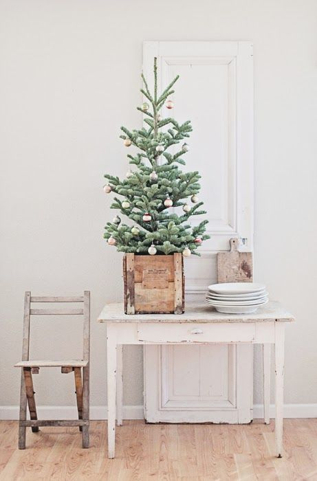 a tabletop Christmas tree in a wooden box and with pastel color block otnaments feels a bit retro and a bit rustic