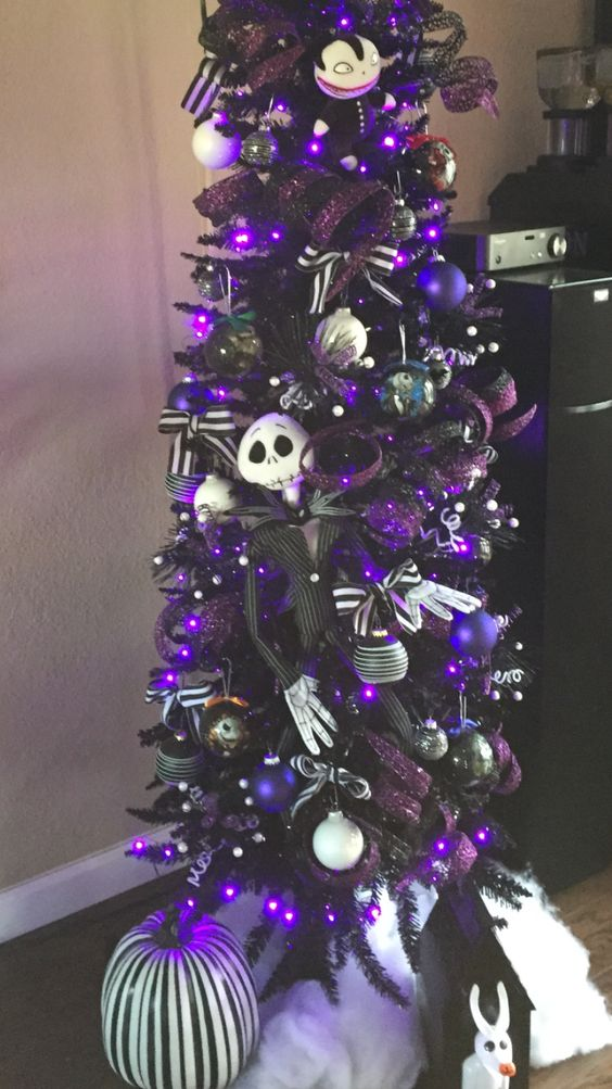 a tall black Christmas tree with purple ornaments, striped bows, Jack Skellington ornaments is gorgeous