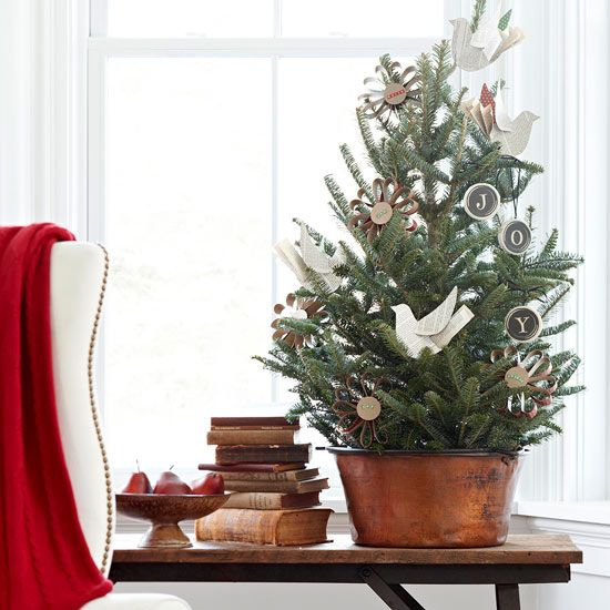 a vintage rustic tabletop Christmas tree with paper birds, chalkboard ornaments and cardboard ones is a lovely and eays idea