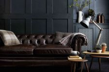 black paneled walls like these ones look refined, chic and bold and bring a touch of exquisiteness to the space