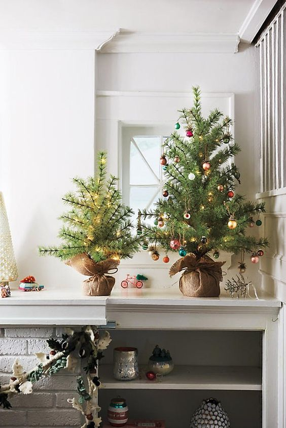 pretty tabletop Christmas trees   one decorated with lights, another one with small colorful ornaments and lights