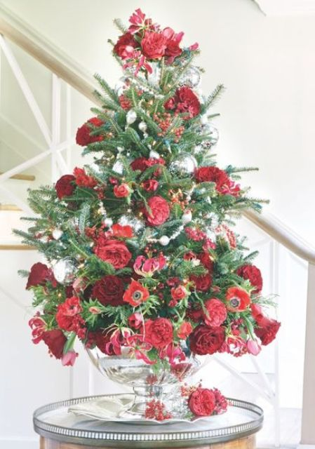 unique tabletop Christmas tree decor done with red berries, red and burgundy blooms and some silver ornaments is chic and glam