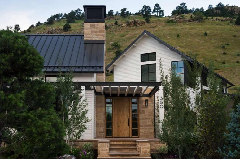 This stylish modern farmhouse features three structures and a strong connection to outdoors