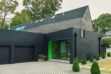 01 This stylish modern house is built in NYC suburbs and its facade is inspired by 1930s houses that surround it