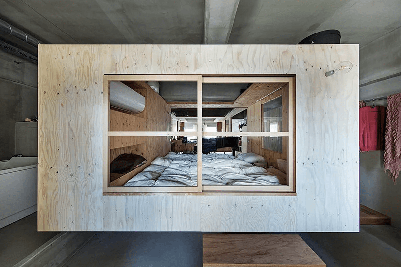 Minimalist House With A Suspended Nest Inside