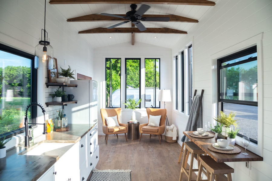 The interior has a farmhouse style vibe and feels fresh bright and open