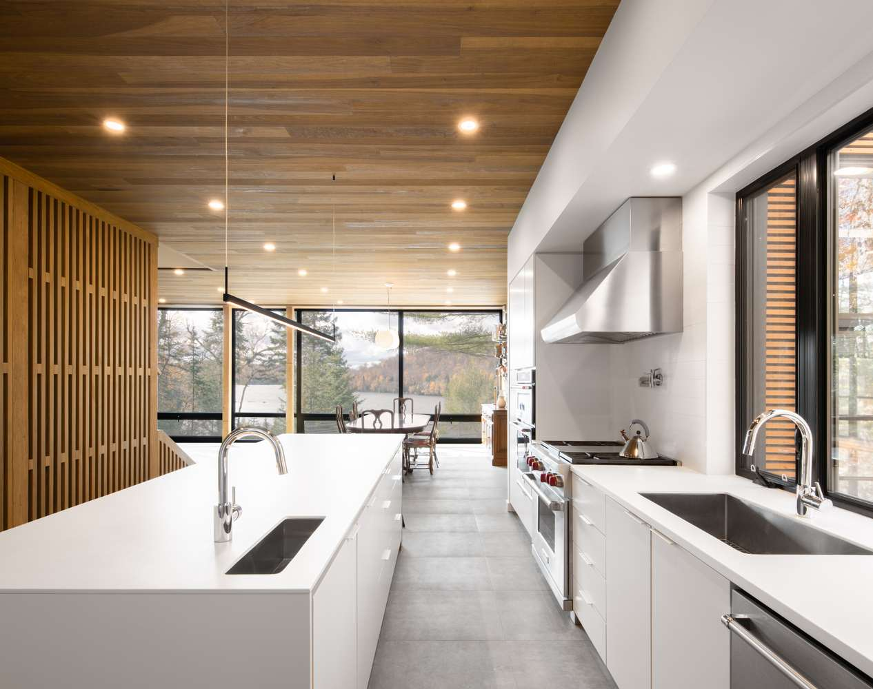a modern kitchen with a stylish wooden ceiling