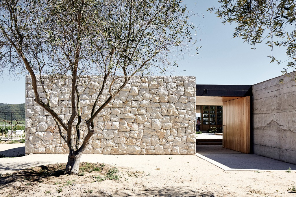 White stone walls enclose the four volumes, of which the house consists