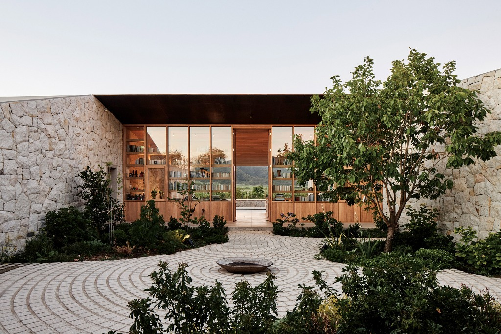 Glass walls allow views from the courtyard to the mountains